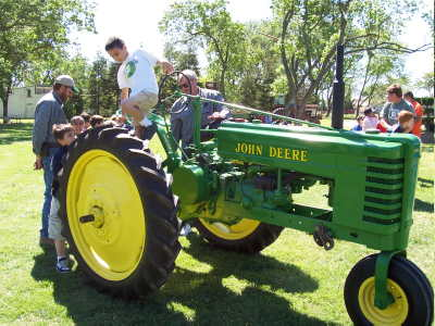 rusty acres ranch john beard behind the tractor at colusa farm days 2004